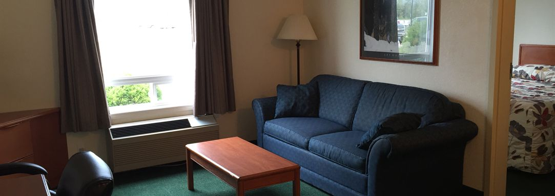 Living space with couch and coffee table at Andersen Inn and Suites in the Pas Manitoba